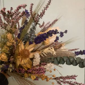 dried flowers by the dancing daffodil