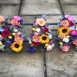 floral letter tribute for funerals by the dancing daffodil