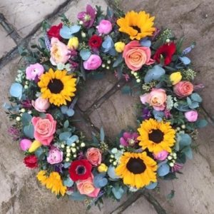 seasonal wreath for funerals by the dancing daffodil