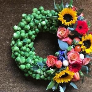 specialist wreath made of sprouts and seasonal flowers